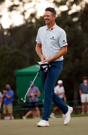 Justin Rose is all smiles after finishing on no. 18 during Thursday's first round for the Masters at Augusta National Golf Club, Thursday, April 8, 2021, in Augusta, Georgia.
