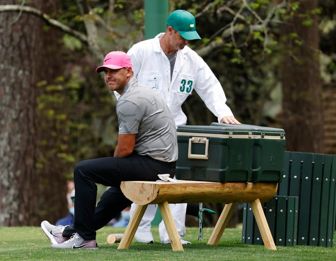 Brooks Koepka takes a seat on the 16th tee during Thursday's first round of the Masters. The four-time major champion is coming off knee surgery on March 16.