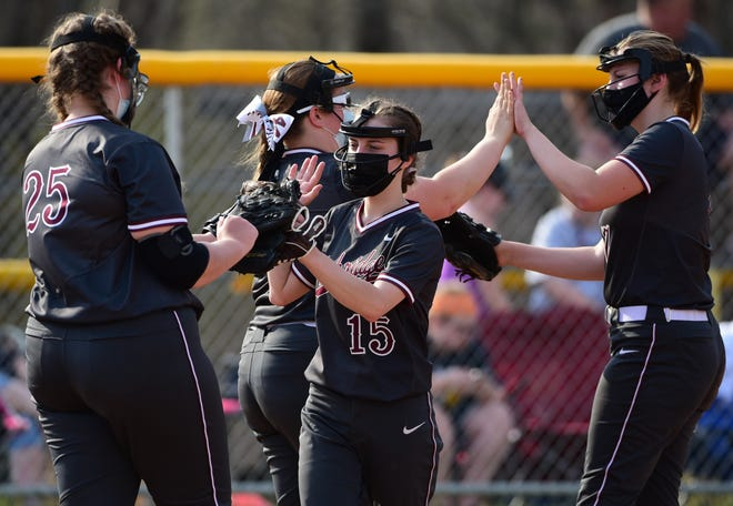 Ambridge softball players high five each other before the 4th inning of their game against Hopewell Wednesday at Ambridge Area Middle School.