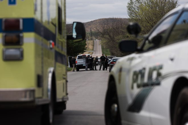 The Bartlesville Police Department on the scene of standoff in a field near the intersection of Washington Boulevard and Price Road on Wednesday.