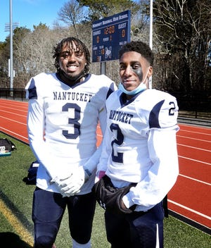 "Brothers Malique, left, and Makai Bodden use their competitiveness with each other to their advantage on the Nantucket High School football team. Head coach Joe Perry says, ""I think growing up in the same household has built their chemistry. They can almost anticipate what the other is going to do and it has left a good mark on the football field."""