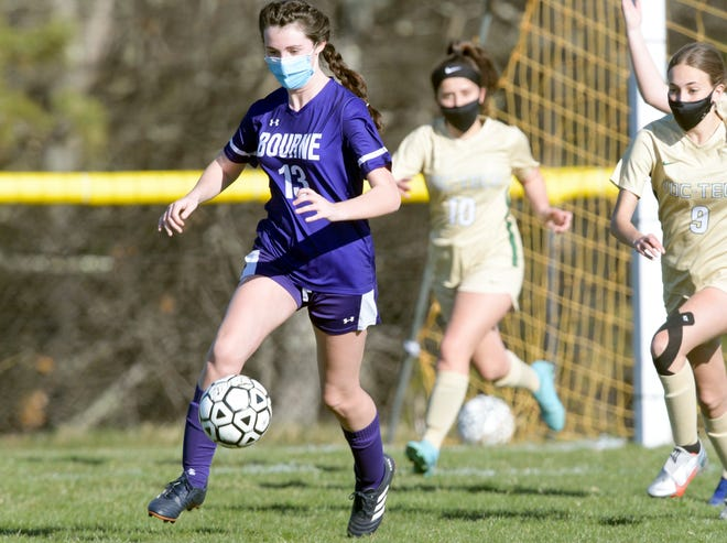 Cassidy Bonzagni of Bourne races ahead of Kaitlyn Duarte of Greater New Bedford Voke to control the ball.