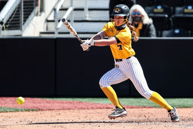 Missouri's Jenna Laird (3) puts the ball in play during a game against Auburn on March 28 at Mizzou Softball Stadium.