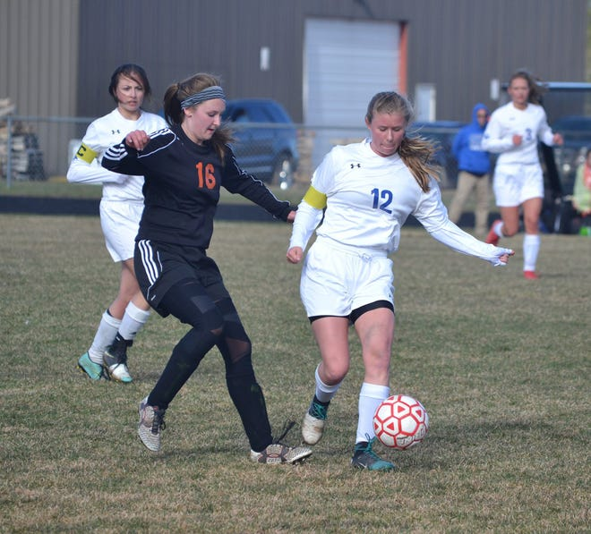 Cheboygan midfielder Cassie Barton (left) battles for the ball during a home varsity girls soccer contest in 2019. Barton, a top midfielder, is one of 10 seniors returning to this year's Cheboygan squad.