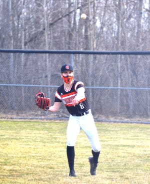 Cheboygan junior Daniel Wilcome makes a throw from right field during game one of a doubleheader against Harbor Springs on Tuesday.