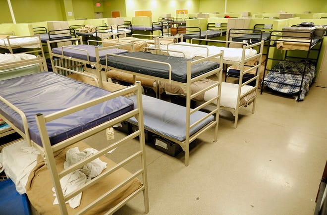 In this 2019 file photo, beds at the Van Buren Shelter in Columbus are seen. A count of emergency shelters in Columbus and Franklin County showed an 18% decrease in people over the past year, which some attribute to the eviction moratorium.