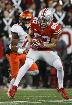 Ohio State receiver C.J. Saunders, here making a reception against Illinois on Nov. 18, 2017, missed the past two seasons.