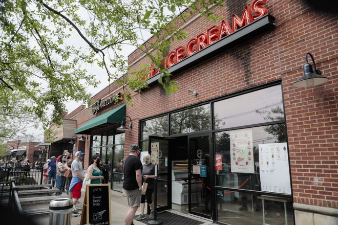 Patrons line up outside Jeni's Splendid Ice Creams, 4247 N. High St., for the release of its Strawberry Pretzel Pie ice cream on Thursday in honor of country music star Dolly Parton. About 100 people lined up outside the store prior to its opening.