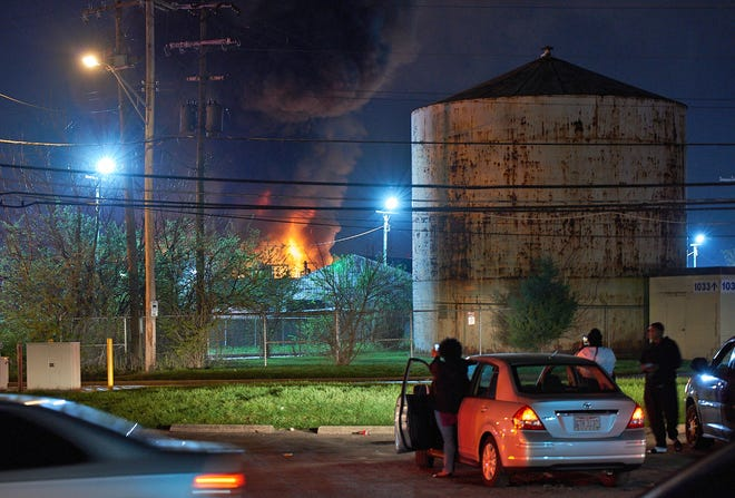 Smoke pours from the Majestic Paints building where an explosion occurred overnight leaving eight people injured and one missing near Leonard Avenue in Columbus, Ohio on April 8, 2021.