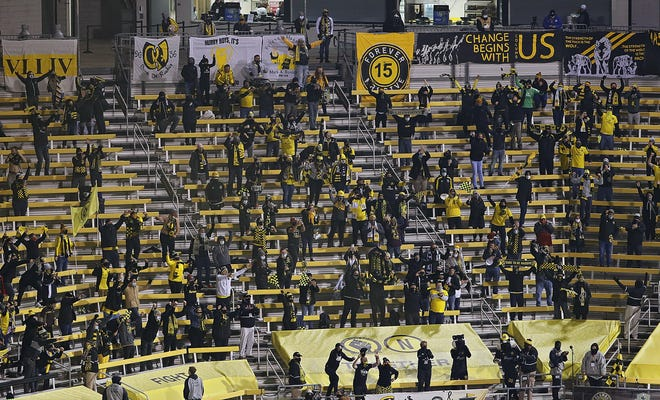 Columbus Crew SC fans celebrate after beating the Seattle Sounders FC 3-0 to win the 2020 MLS Cup at MAPFRE Stadium in Columbus, Ohio on December 12, 2020. An estimated 1,500 fans were permitted inside the stadium.