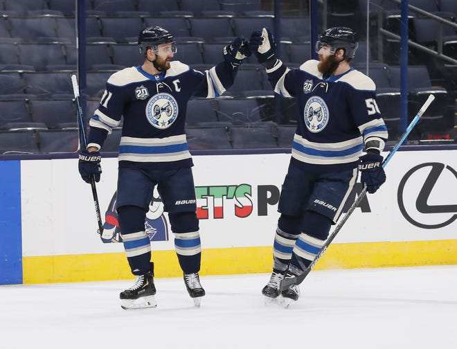 Left wing Nick Foligno, left, and defenseman David Savard are Blue Jackets mainstays, but they are drawing a lot of interest as the NHL trade deadline nears.