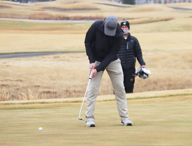 Blaine Andringa putts during the Grafton Invitational on April 8 at King's Walk Golf Course. Andringa shot an 83, the second-best score on the team, at the Detroit Lakes Invitational on Friday.