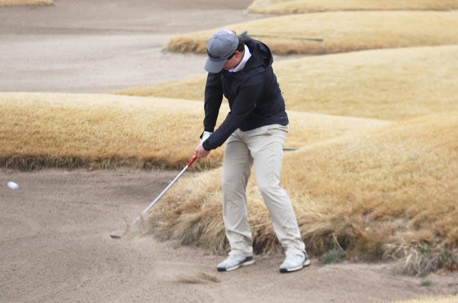Blaine Andringa hits out of a bunker during the Grafton Invitational on April 8 in Grand Forks. Andringa led the Crookston boys' golf team by shooting a 96 at the Pequot Lakes Invitational.