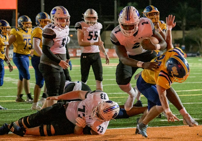 Mount Dora Christian Academy quarterback Tyquan Wiggins (2) powers into the end zone at the Sunshine State Athletic Conference championship game Nov. 21, 2020 against Orlando Christian Prep at Bryant Stadium in Lakeland. [PAUL RYAN / CORRESPONDENT]