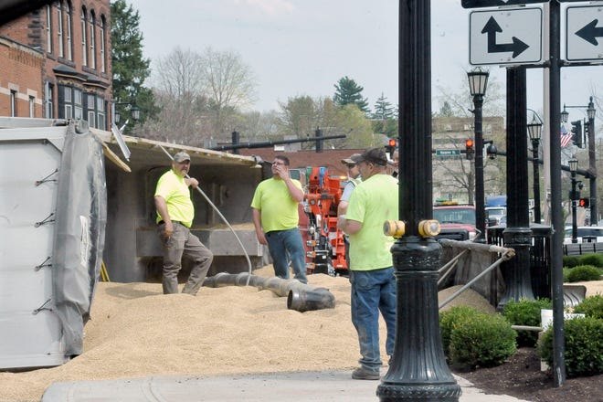 This tractor-trailer load of grain slowed traffic in downtown MIllersburg after it tipped over in front of the courthouse on the square Thursday afternoon.