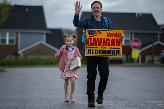 Ward 3 incumbent Alderman Kevin Gavigan walks his daughter Lucy to school on Election Day  in Spring Hill, Tenn., on Thursday April 8, 2021.