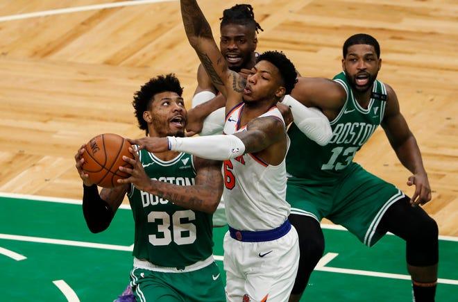 Apr 7, 2021; Boston, Massachusetts, USA; New York Knicks guard Elfrid Payton (6) defends Boston Celtics guard Marcus Smart (36) during the third quarter at TD Garden.
