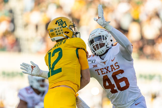 Texas linebacker Joseph Ossai (46) pressures Baylor quarterback Charlie Brewer (12) in the first half of an NCAA college football game on Saturday, Nov. 23, 2019, in Waco, Texas.