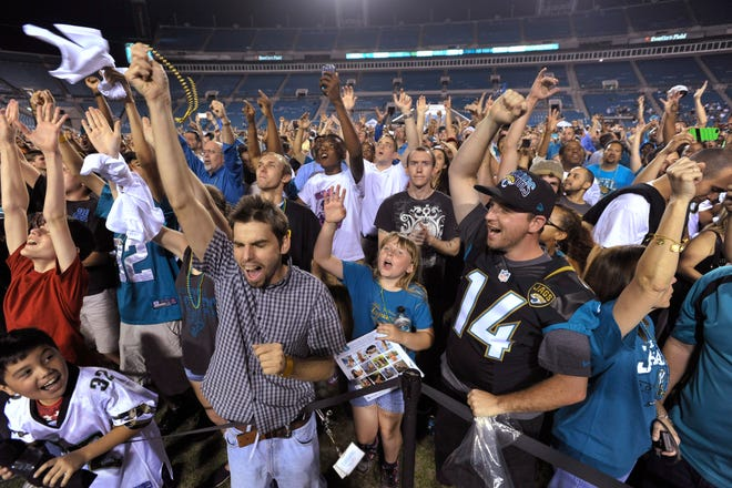 Jaguars fans cheer the selection of offensive tackle Luke Joeckel of Texas A&M in the first round of the NFL draft during a draft party at EverBank Field Thursday night, April 25, 2013 in Jacksonville, Florida.