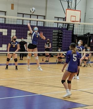 Monty Tech's Skyla Pulver (3) spikes the ball during the Bulldogs' match against South Lancaster Academy, Wednesday, at Bulldog Gym in Fitchburg.