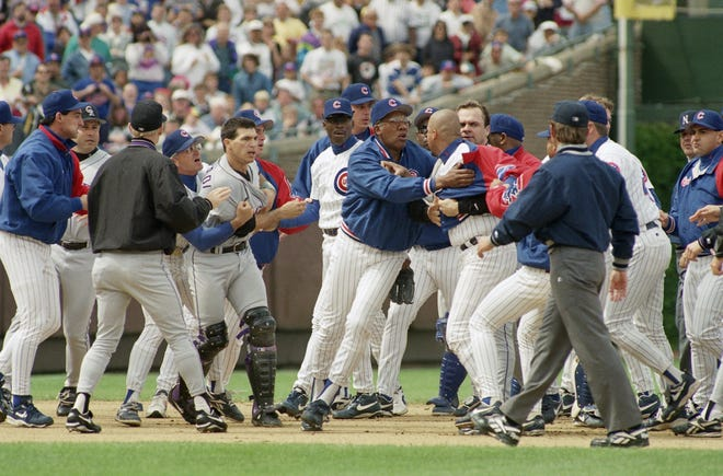 Colorado Rockies catcher Joe Girardi, fourth from left, is restrained as Chicago Cubs pitching coach Fergie Jenkins holds back Cubs Jaime Navarro during a sixth inning fracas at Wrigley Field on Sunday, June 11, 1995 in Chicago.