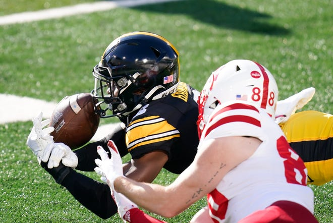 Iowa defensive back Matt Hankins breaks up a pass intended for Nebraska wide receiver Levi Falck (88) during the first half of a game on Friday, Nov. 27, 2020, in Iowa City, Iowa.