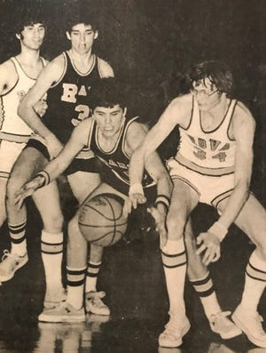 ROVA's John Bloss and Riverdale's Rich Nitz scramble for a loose ball in one of the two meetings during the 1975-76 season between the Tigers and the Rams.