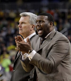 Former Illinois head coach Bruce Weber, left, and assistant coach Jerrance Howard watch from the sidelines during the second half of a game against Michigan at Crisler Center in Ann Arbor, Mich., Sunday, Feb. 12, 2012.