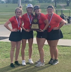 From left, Addy Turner, Kylie Frush, Emery Brewer and Taylee Whalen pose with the trophy after placing second at the District 6-4A golf tournament in Gatesville on Monday.