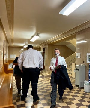 Judge Jim Fallon arrives at the Grayson County Courthouse Wednesday morning for the second day of testimony in the Timothy Barnum murder trial.