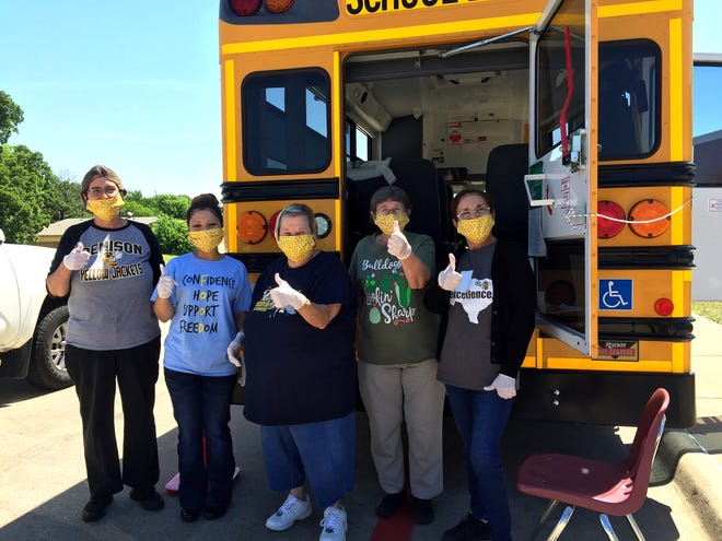 """Houston Elementary's team of Food Service Heroes eagerly awaited the arrival of parents and students who came daily to pick up breakfast and lunch during the six-months when schools were closed because of the coronavirus. """"During the shutdown, we used DISD Suburbans to deliver food to 41 key sites (compared to 15 sites the previous year), including all of our campuses where buses served as meal distribution centers…as well as many homes and low-income apartment complexes in all areas of our community,"""" said DISD Food Service Director Debbie Hosford."""