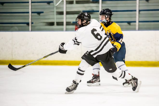 West Ottawa senior Jake Neitzel passes the puck during a game