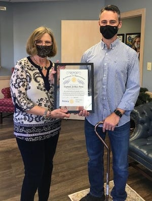"""Hendersonville Fire Department Ret. Capt. Josh Poore poses with former Hendersonville Rotary Club President Sheila Grapes after receiving the 2019-20 """"Non-Rotarian Outstanding Professional Achievement"""" award from the club."""