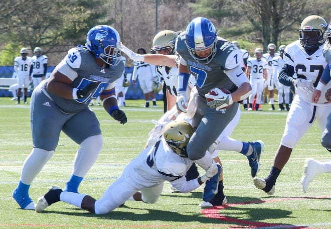 Brevard College tight end Dalton Cole (7), a former West Henderson High standout, scores one of his three touchdowns against NC Wesleyan on Saturday. [VICTORIA BRAYMAN/ BREVARD COLLEGE ATHLETICS]