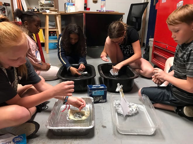 In summer 2019, Club members made boats from aluminum foil and tested how much weight their designs could hold before sinking.
