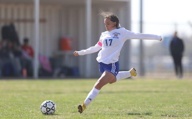 Hutchinson senior Josie Hallier takes a free kick at the Titan Classic at Wichita South High School.