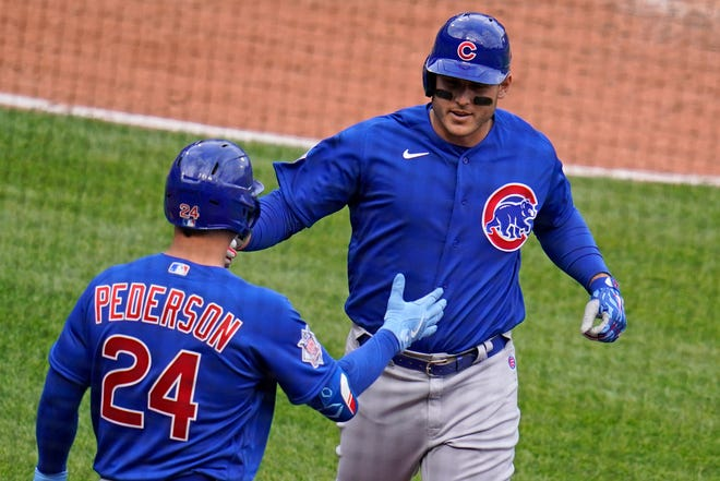 Chicago Cubs' Anthony Rizzo, right, returns to the dugout after hitting a solo home run off Pittsburgh Pirates relief pitcher Sam Howard during the eighth inning of Thursday's game.