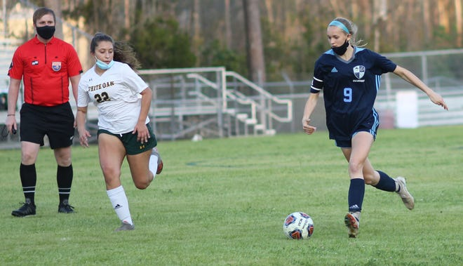 Swansboro's Reagan Baiotto dribbles the ball up the field against White Oak earlier this season.