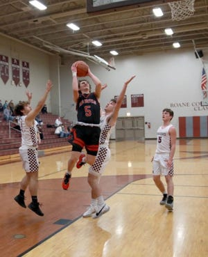 Ravenswood freshman Beau Bennett (5) drives to the basket in a recent game at Roane County. Bennett scored 12 points on four 3-pointers in a Devil win over Parkersburg Catholic April 6.