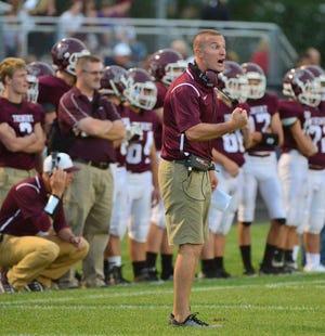 Tremont football coach Zach Zehr talks to his team.