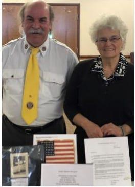 Pictured are Jim Garrison, Post Adjutant and Elizabeth Siman, great niece of David Hudson.