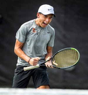 Lakeland junior Sam Reeder celebrates the win against All Saints' Jacob Bruschayt in the championship match during the Polk County Tennis Finals at the Beerman Family Tennis Center.