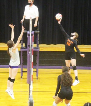 La Junta High School's Sierra Reisch (10) hits the ball over the net as Cheraw's McKenzie Bartholomew (1) looks to block the shot in Wednesday's match at the Wolverines Den. The Tigers defeated the Wolverines in five sets.