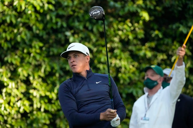 Cameron Champ watches his tee shot on the second hole during a practice round for the Masters golf tournament on Wednesday, April 7, 2021, in Augusta, Ga.