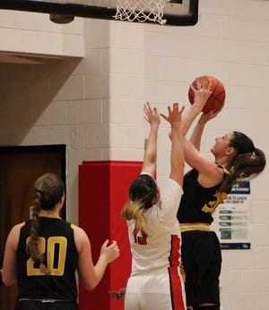 Keyser's Kaili Crowl goes up for two of her team-high 15 points against Petersburg Wednesday.