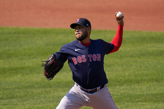 Boston Red Sox starting pitcher Eduardo Rodriguez throws a pitch against the Baltimore Orioles during the first inning of a baseball game, Thursday, April 8, 2021, on Opening Day in Baltimore. (AP Photo/Julio Cortez)