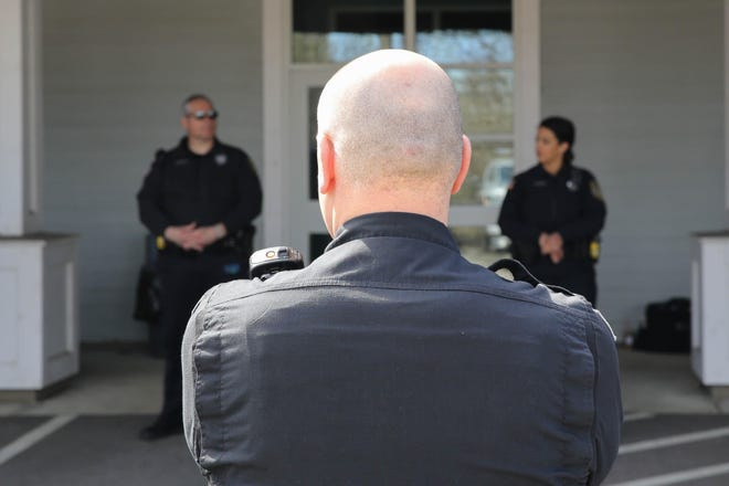 Holliston police Sgt. Todd Hagan leads a roll call last year outside the department. Police are seeking to raise $25,000 through GoFundMe to pay for a new community service dog.