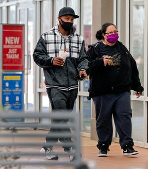 Shoppers wear masks at the OKC Outlets Mall in Oklahoma City on April 8. The city council's mask mandate is set to expire April 30. Public health officials continue to urge social distancing, hand-washing and and mask-wearing as precautions against spread of COVID-19.