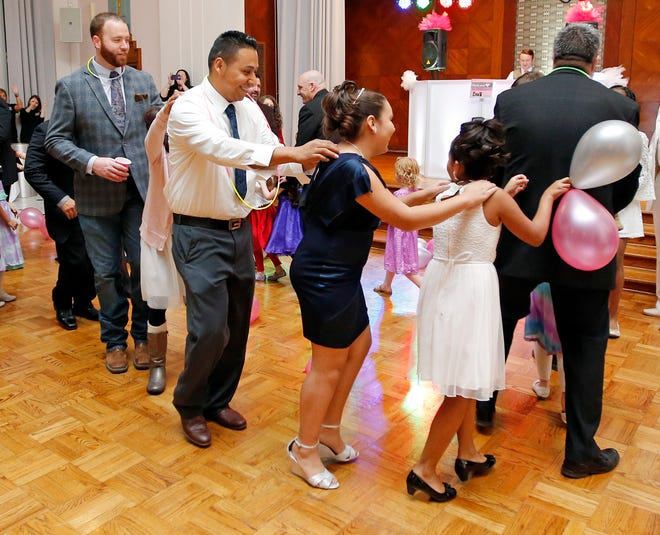 A conga line forms during a previous year's Daddy Daughter Dance organized by Oklahoma City Parks and Recreation
