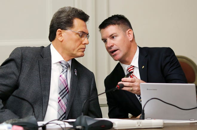 Oklahoma Republican Party Chairman John Bennett, seen here at right talking with Karma Saleem, on Sunday addressed a Facebook post made on the party's page that likened mandatory COVID-19 vaccinations to the persecution of Jews during the Holocaust.